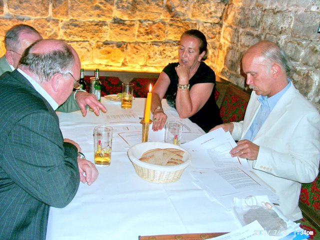 Anita Paré in discussion with Mathias Binder & Fr. Klaus Hermann; Mark reviews information packet<br>Click to enlarge